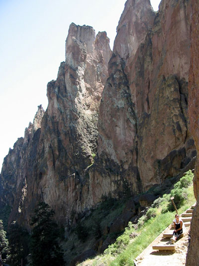 Resting on trail with Smith Rock Group in background